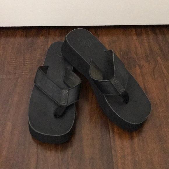 reef black leather flip flops